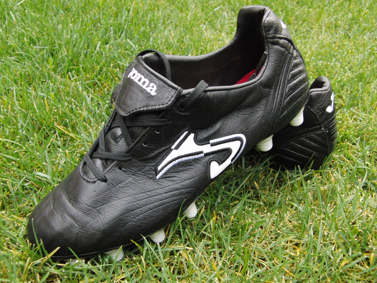 black joma total fit football boots